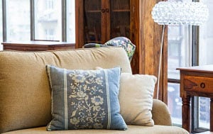 blue-pillows-on-brown-couch